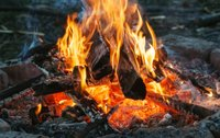 Closeup shot of burning fire with hot red embers in it, selective focus